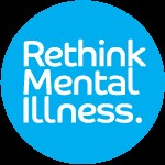 """Logo with text """"Rething Mental Illness"""" in white text on a light blue circle in a black box background"""